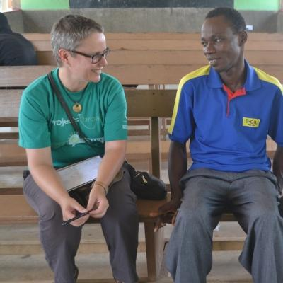 A Projects Abroad staff member and intern give advice to an entrepreneur during our Micro-finance placement in Ghana